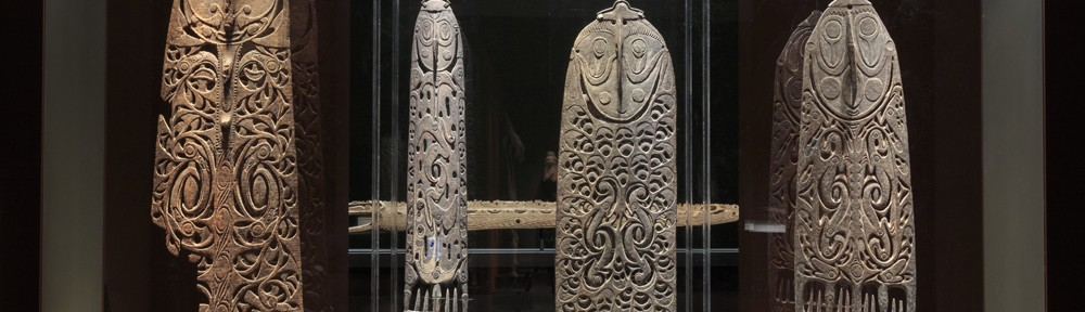 Four impressive Malu plaques from Australian  museum collections are at the heart of the Myth +Magic exhibition at the National Ga;llery of Australia. Malu plaques from East Sepik Province are objects of mystery, since these  obviously important  ritual carvings ceased to be used  more than 100 years ago and little is known about them. Some believe them to have been carved  by the Sawos people and traded into Iatmul men's houses for use in mortuary or initiation rites or in ritual skull displays. Left to right: 1. Malu plaque, 19th century , wood,181 x 57 x 8 cm, National Gallery of Australia, Canberra, acquired from Anthony Forge,1977. 2. Malu Plaque, 19th to early 20thcentury, wood , ochre, 187 x 46.8 x 7.5 cm, on loan from Museum Victoria X42471,acquired form George William Lambeth Townsend, 1935. 3. Malu Plaque, Torembi Village, 19th to early 20thcentury, wood ,ochre, 138 x 24.5 x 7 cm, on loan from Museum Victoria X42470,acquired form George William Lambeth Townsend, 1935. 4. Malu plaque ,19th or early 20th century, wood, ochres, fibre, 154.4 x 46.5 x7.4 cm, on loan from the Queensland University Museum of Anthropology, 23100.